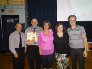 Pictured from left to right is Mr. Louis DeLisio (Superintendent), Mr. Sam Juliano (Teacher), Mrs. Lea Turro (Lincoln School Principal), Mrs. Bethany Hegedus (Author) and Mr. Evan Turk (Illustrator).