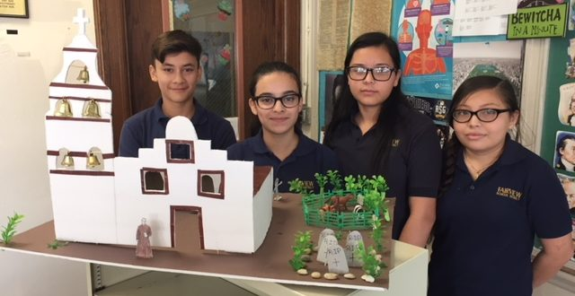 Photo of Hands on Learning at Lincoln School displaying students with finished model of a Spanish Mission.