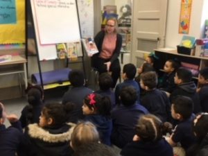 Photo of community member reading a book for Read Across America