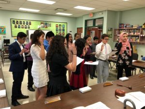2018 Board Member for a Day Students Participating with the recieving the oath of office