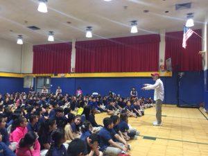 Red Grammar Anti-Bullying Program at Number Three School speaks to crowd.