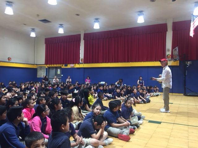 Red Grammar Anti-Bullying Program at Number Three School speaks to crowd.
