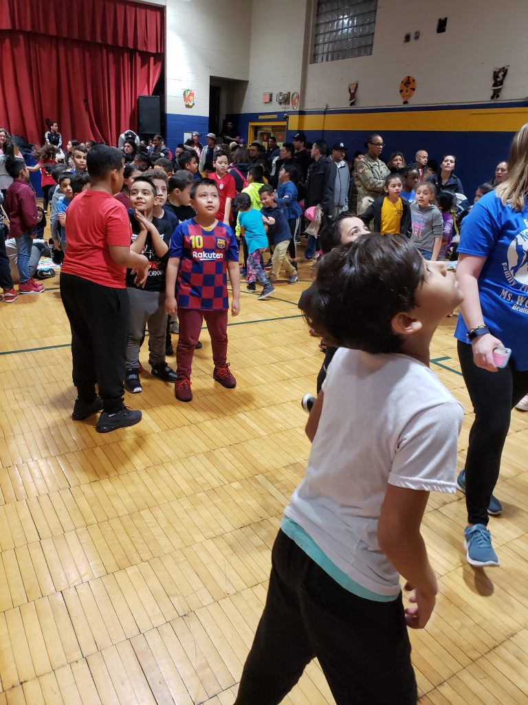 Photos depicting children playing at Number Three School Family Fitness Night